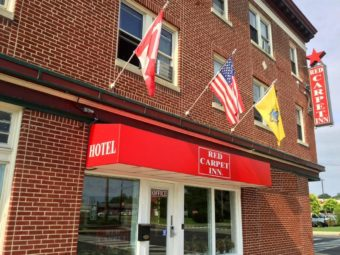 Hotel entrance, wall mounted flags, hotel brand signage