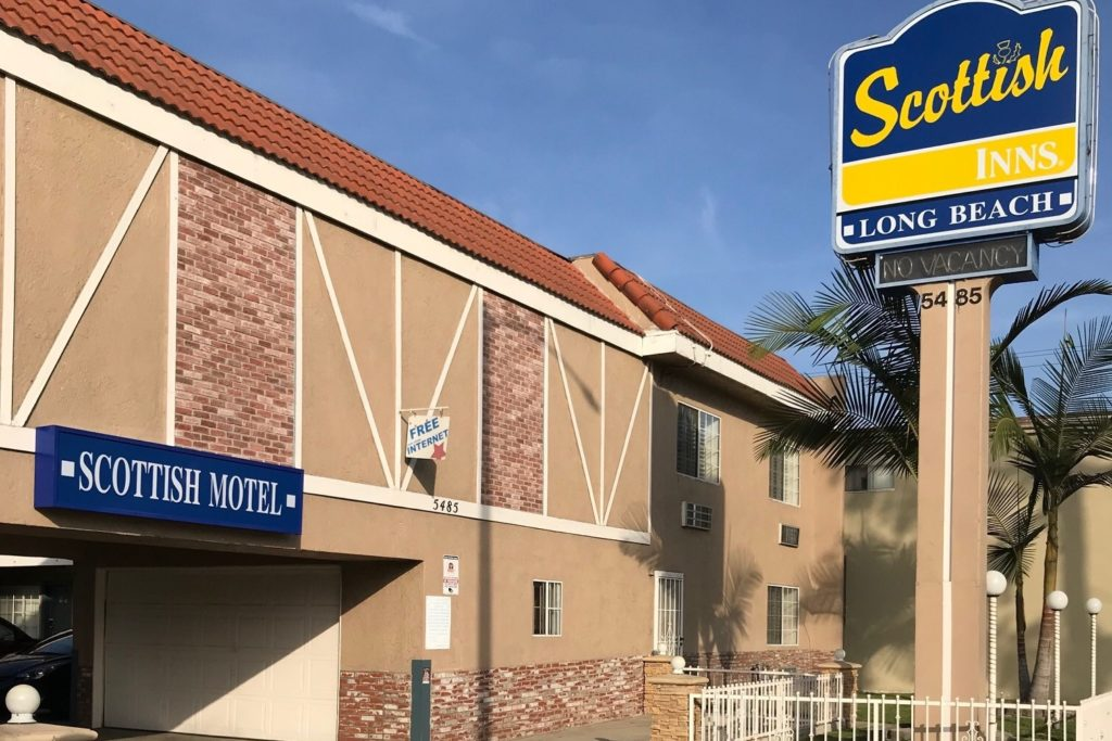 Hotel exterior and drive through entrance, brand signage