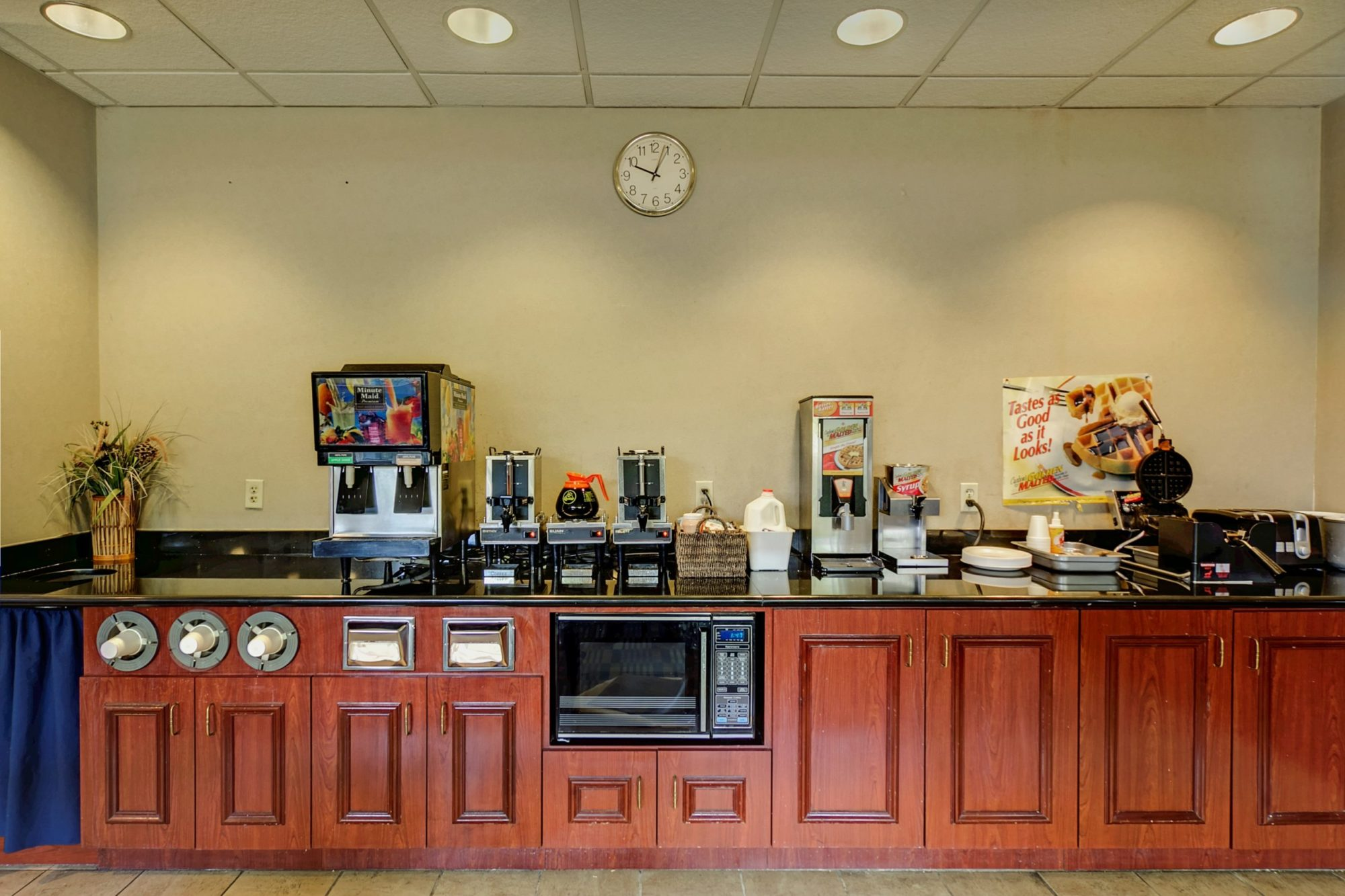 breakfast display with coffee, juice machines, waffle maker and toaster