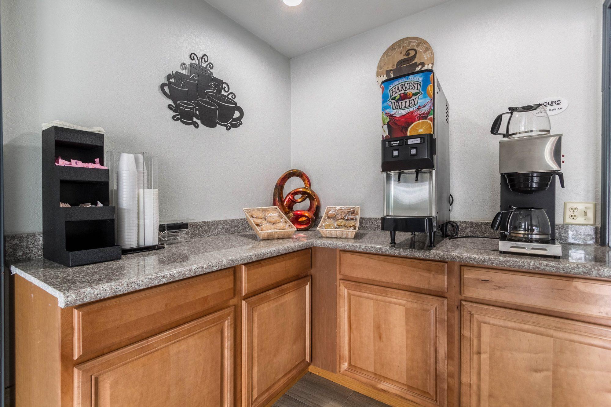 Breakfast display counter wityh juice machine, coffee machine, baskets with breakfast pastries